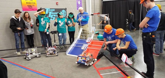 Teams practice with their robots.